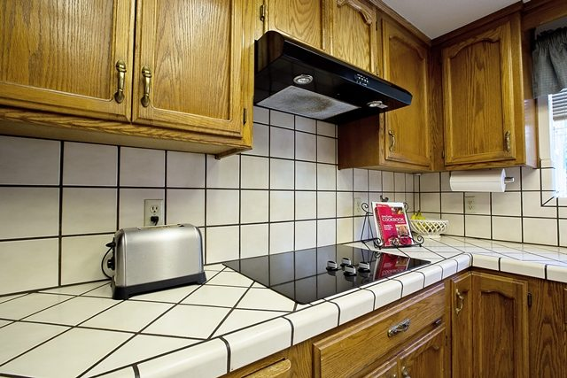 dated cabinets and countertops.