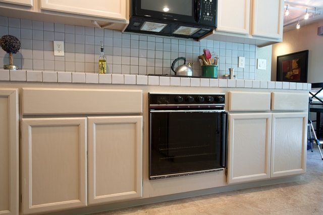 dated cabinets, appliances, and countertops.