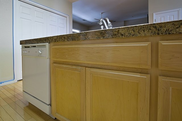 dated cabinets and counter.